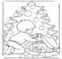 Jongen bij kerstboom